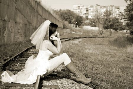 Runaway Bride. woman in a wedding dress photo