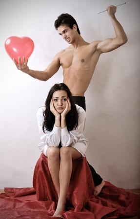 sad girl and strong man photo