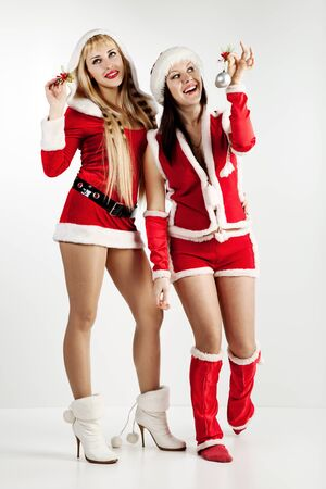 attractive girls in xmas clothing Stock Photo - 8544276