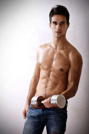 attractive young athlete with dumbbell Stock Photo