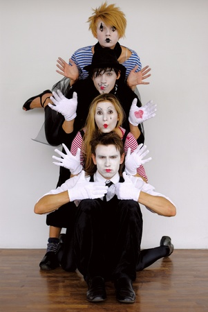four mime actors in action photo