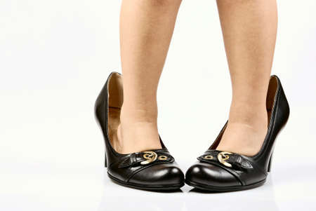 child legs in elegant adult shoes photo