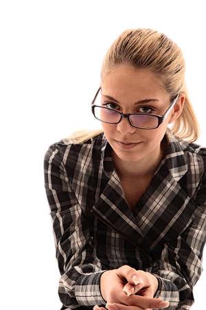 attractive girl looks through glasses. studio shot Stock Photo - 9567824