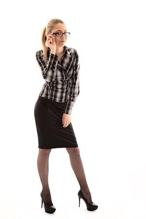 buisiness: attractive girl looks through glasses. studio shot Stock Photo
