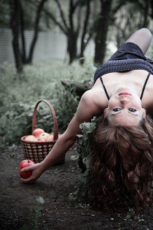 girl holding an apple. outdoor portrait