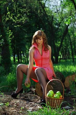 crop margin: girl holding an apple. outdoor portrait