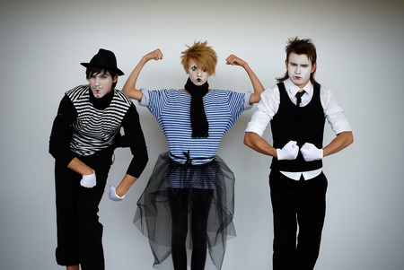 three mime actors in action photo
