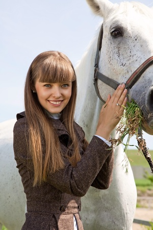portraite of attractive girl and horse. outdoor shot photo