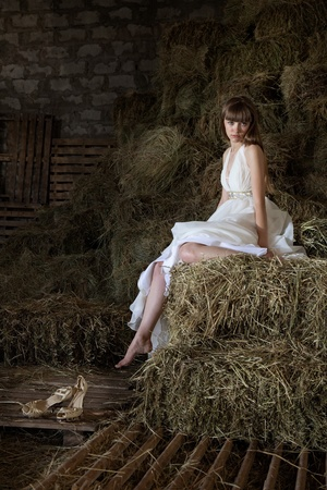 sad lonely girl: attractive girl in the hay. runaway bride Stock Photo