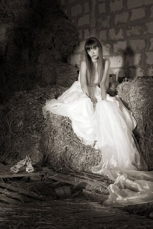 barn girls: attractive girl in the hay. runaway bride Stock Photo