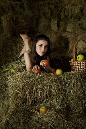 attractive girl in the hay. rural portrait photo