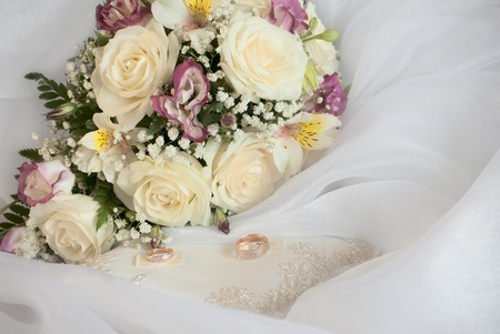 wedding still life. bridal bouquet and the ring photo