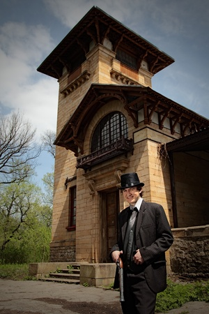 old style man standing near house Stock Photo - 10570438