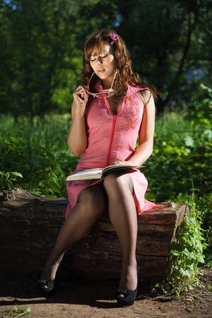 girl reading book. outdoor shot photo