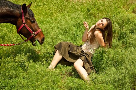 light brown horse: portraite of attractive girl and horse. outdoor shot Stock Photo
