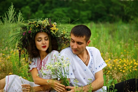pair of man and woman. man give flowers to girl. outdoor shot photo