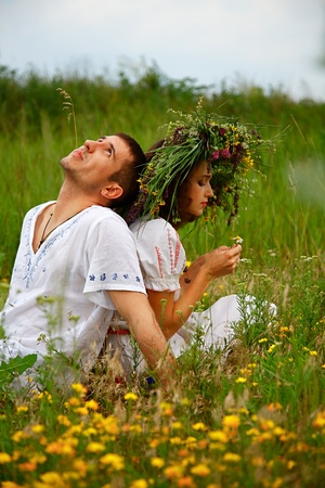 divination: pair of man and woman. Divination by daisy. outdoor shot Stock Photo