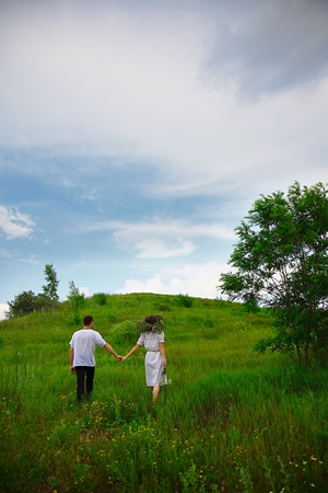 pair of man and woman walking on nature. outdoor shot photo