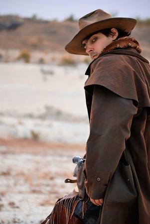 handsome cowboy in specific clothing with weapon. outdoor shot Stock Photo - 11170142