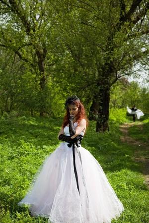 awaiting: awaiting upset bride girl. outdoor shot