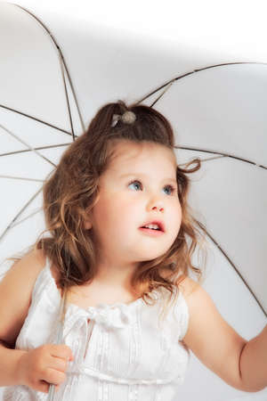 portrait of attractive young girl in white dress with umbrella photo