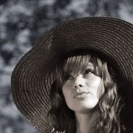 portrait of attractive girl in hat with large fields Stock Photo - 12275073