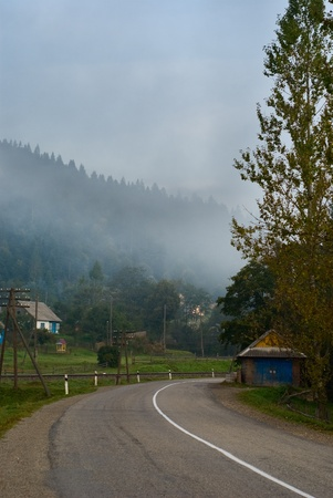 mountain road in the Carpathians. turn in the road Stock Photo - 12793412