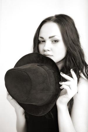 portrait of attractive girl in hat. Studio shot Stock Photo - 13428636