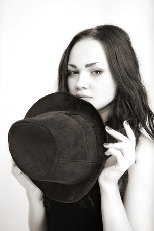 portrait of attractive girl in hat. Studio shot Stock Photo - 13428636