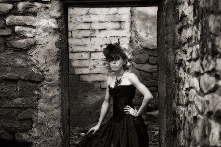 attractive woman in old style black dress. outdoor shot Stock Photo - 15200602