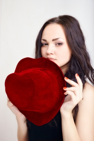 attractive girl with a hat in the shape of heart. Studio shot photo