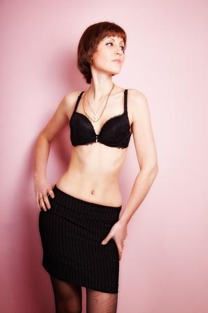 navel piercing: navel piercing beautiful woman. indoor shot Stock Photo