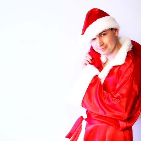 portrait of attractive Xmas Santa Claus. indoor shot photo