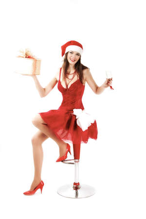 attractive woman in Xmas costume offers gift. studio shot photo