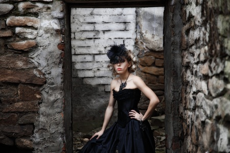 attractive woman in old style black dress. outdoor shot Stock Photo - 16249263