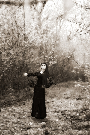 woman in old style black dress. outdoor shot photo