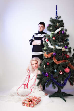 portrait of attractive Xmas couple. indoor shot photo