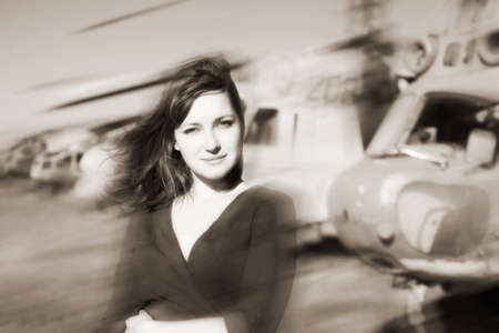 portrait of attractive woman near aircraft photo