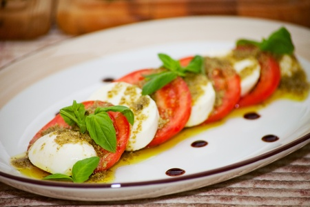 Caprese salad with sause Pesto photo