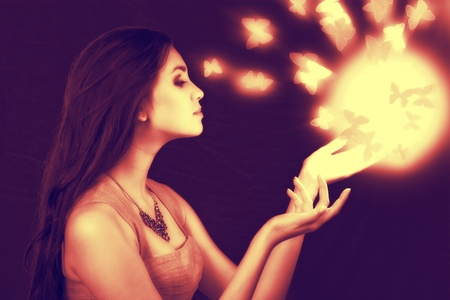 lighting sphere in hands. attractive fairy girl photo