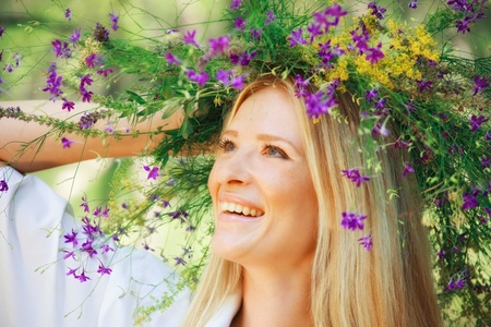 wreath of flowers on head of girl  outdoor shot photo