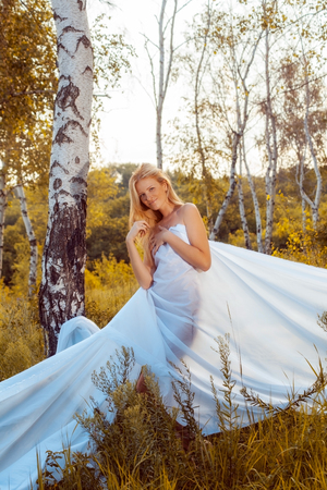 girl wrapped in white fabric  outdoor shot