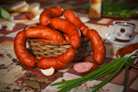 stillife: Stillife with sausage, spices and greens Stock Photo
