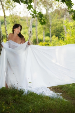 girl wrapped in white fabric. outdoor shot