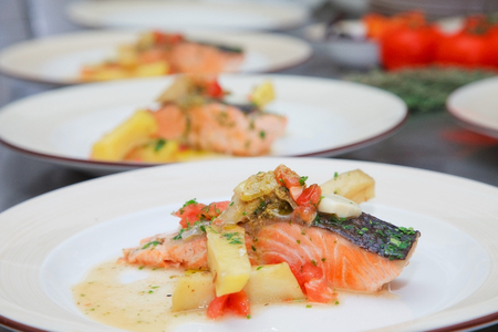 grilled salmon with potatoes and sauce photo