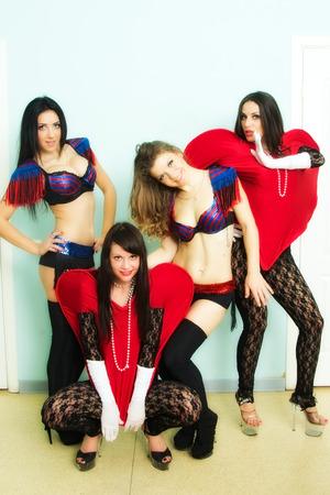 portrait of girls in exotic costumes. indoor shot photo