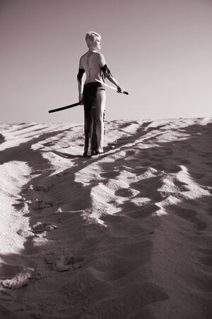 militant: militant girl with sword in morning light