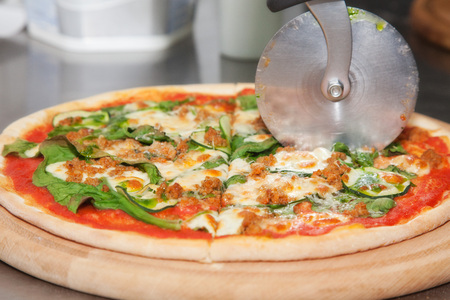 raw pizza with squash and tomato sauce photo