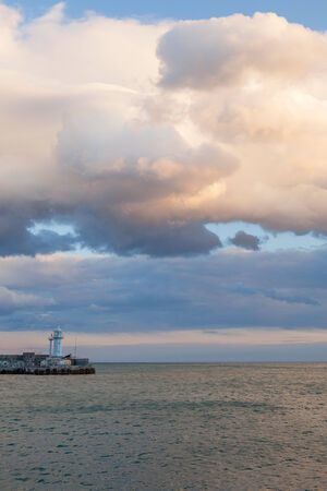 landscape with a lighthouse, sea and sky photo