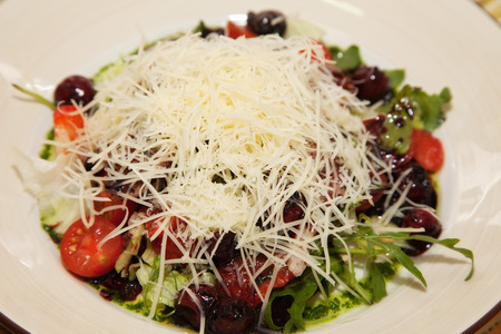 fresh salad with cherry, tomatoes and meat photo